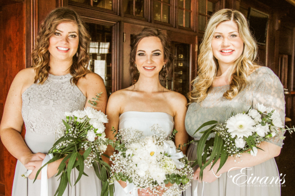 bride and bridesmaids wearing silver and grey colors